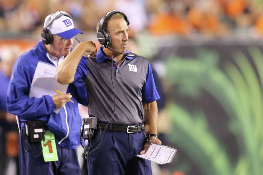 New York Giants defensive coordinator Steve Spagnuolo works the sideline during Friday's preseason game against the Bengals in Cincinnati. Photo: Gary Landers — The Associated Press   / FR171284 AP