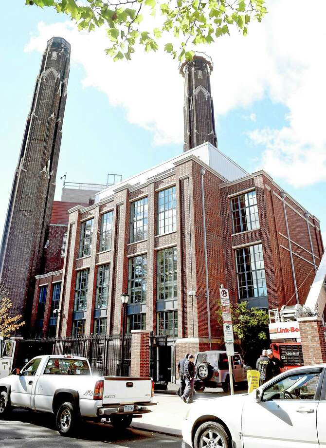 The scene at the Yale Central Power Plant in New Haven where a worker fell forty feet inside a chimney Saturday morning 10/17/2015. The chimney is the shorter of the two towers. Photo: (Arnold Gold-New Haven Register)