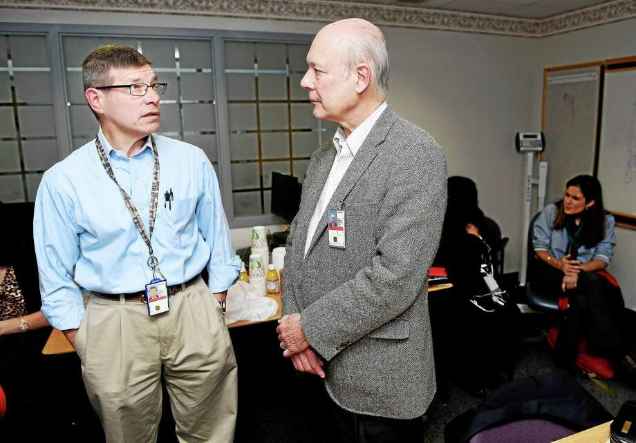 Dr. George Fuller (left), Assistant Chief of Staff, and Dr. Michael Ebert, Chief of Staff, speak after a meeting of clinical department heads concerning patient access at the VA Connecticut Healthcare System in West Haven on 11/14/2015. Photo: Arnold Gold — New Haven Register