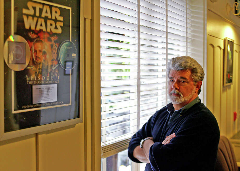 "FILE- In this May 4, 2005 file photo, George Lucas, director of ""Star Wars Episode III: Revenge of the Sith,"" poses at Skywalker Ranch in San Rafael, Calif. The effect ""Star Wars"" has had on movies is as colossal as the Death Star itself and to some, just as fearsome. The new Disney/Lucasfilm release, ""Star Wars: The Force Awakens,"" opens in U.S. theaters on Dec. 18, 2015. Photo: AP Photo/Eric Risberg, File    / AP"