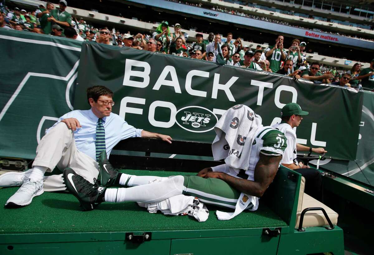 New York Jets defensive back Antonio Cromartie (31) is carted off the field after being injured during Sunday's game against the Cleveland Browns in East Rutherford, N.J.