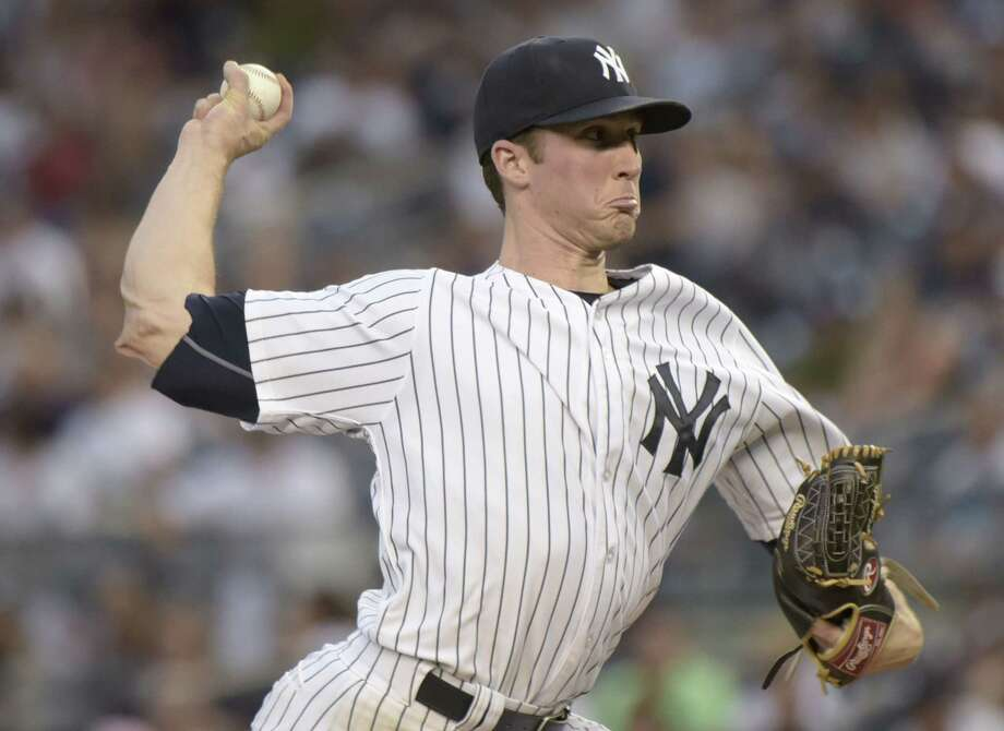 Yankees pitcher Bryan Mitchell delivers the ball during Monday night's game against the Twins. Photo: Bill Kostroun — The Associated Press   / FR51951 AP