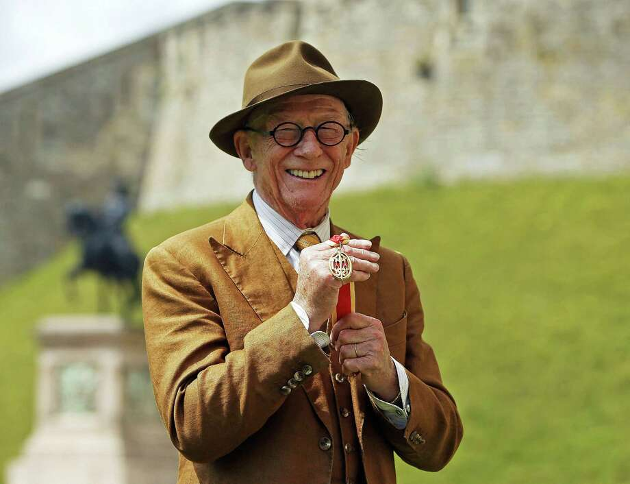 British actor John Hurt holds his award of a Knighthood presented by Britain's Queen Elizabeth II during an Investiture ceremony at Windsor Castle, England, Friday July 17, 2015. (Steve Parsons/PA via AP) UNITED KINGDOM OUT  NO SALES  NO ARCHIVE Photo: Ap / PA