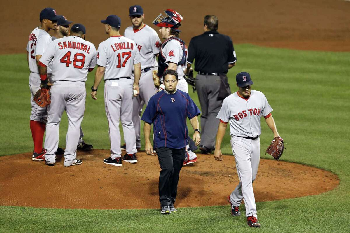 Boston Red Sox starter Joe Kelly, bottom right, walks off the field in the third inning of Tuesday's game against the Orioles in Baltimore.