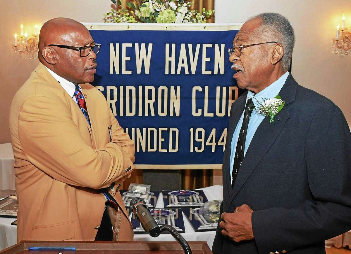Floyd Little, left, greets Hillhouse teammate Bill McCoy, who was inducted into the New Haven Gridiron Club's Hall of Fame.