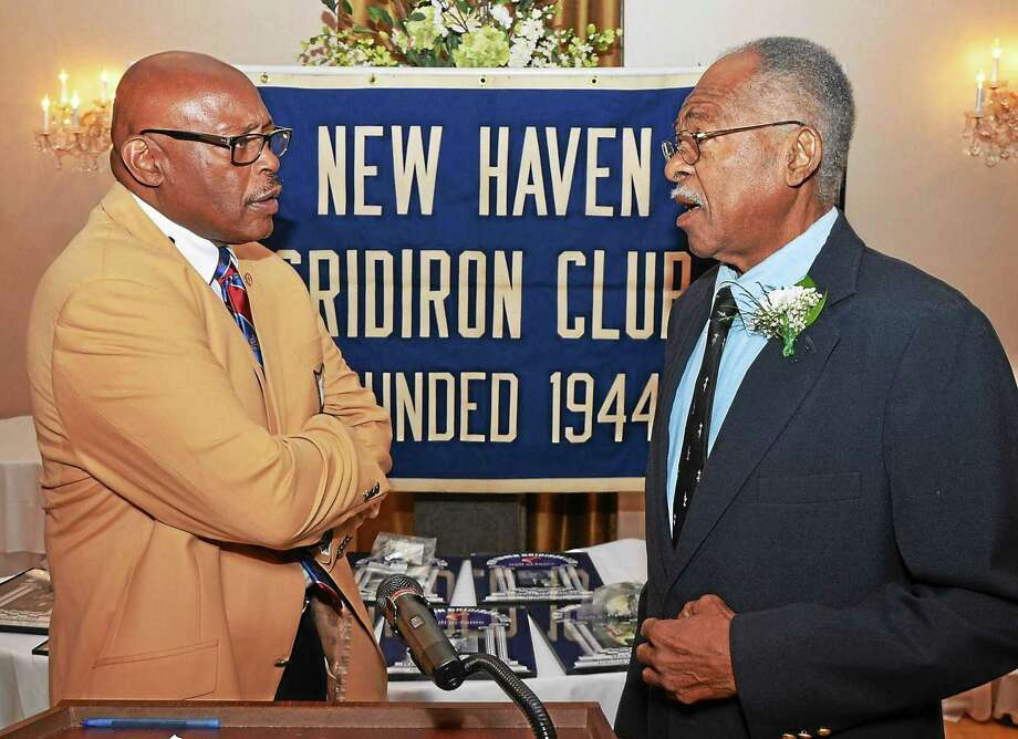 Floyd Little, left, greets Hillhouse teammate Bill McCoy, who was inducted into the New Haven Gridiron Club's Hall of Fame. Photo: COntributed Photo