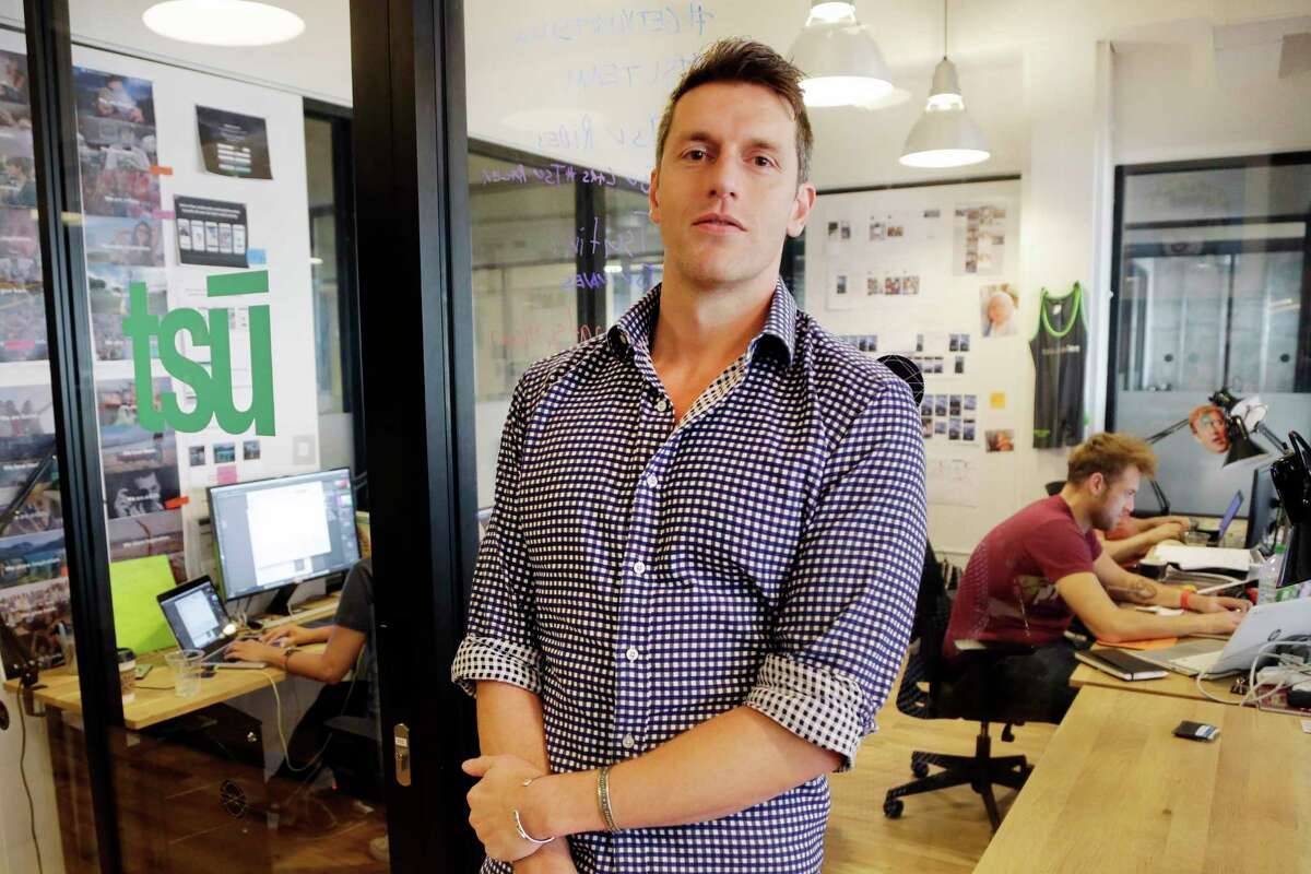 Sebastian Sobczak, CEO of Tsu.co, poses in his company's New York office. Tsu.co is winning converts to its social network by paying them for their posts.