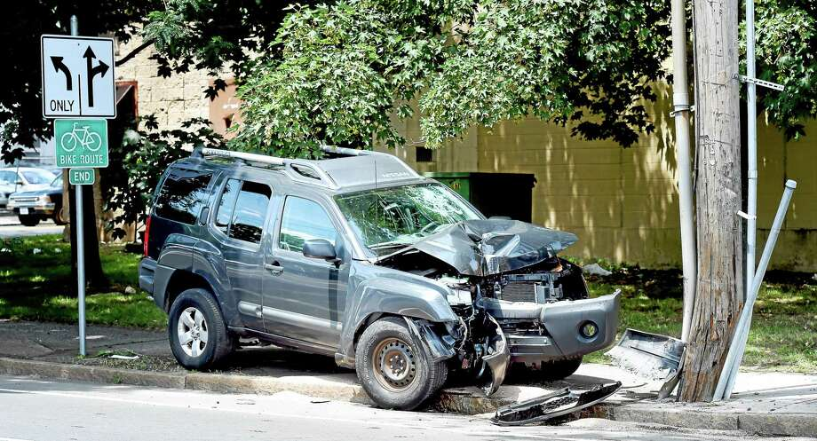 An SUV hit a utility pole on Grand Ave. near East St. in New Haven on 7/17/2015. Photo: (Arnold Gold-New Haven Register)