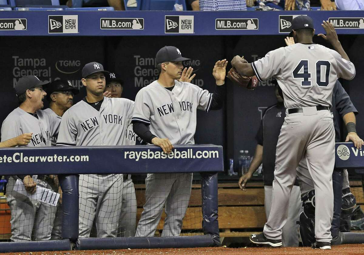 Yankees starting pitcher Luis Severino (40) celebrates with teammates as he is taken out of the game against the Tampa Bay Rays Wednesday. Severino picked up the win in the Yankees' 3-1 victory.