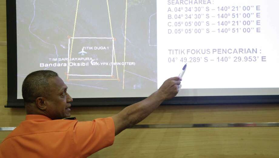 National Search And Rescue Agency (BASARNAS) deputy operations director Heronimus Guru explains a search operation for the missing Trigana Air Service flight during a press conference in Jakarta, Indonesia on Aug. 17, 2015. Smoldering wreckage of the Trigana Air Service turboprop plane was spotted from the air Monday morning in a rugged area of the easternmost province of Papua, rescue officials said. Photo: AP Photo/Tatan Syuflana   / AP