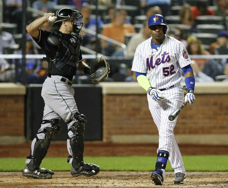 The Mets' Yoenis Cespedes returns to the dugout as Miami Marlins catcher J.T. Realmuto (20) returns the ball to the pitcher after Cesspedes struck out swinging during the sixth inning. Photo: Kathy Willens  — The Associated Press   / AP