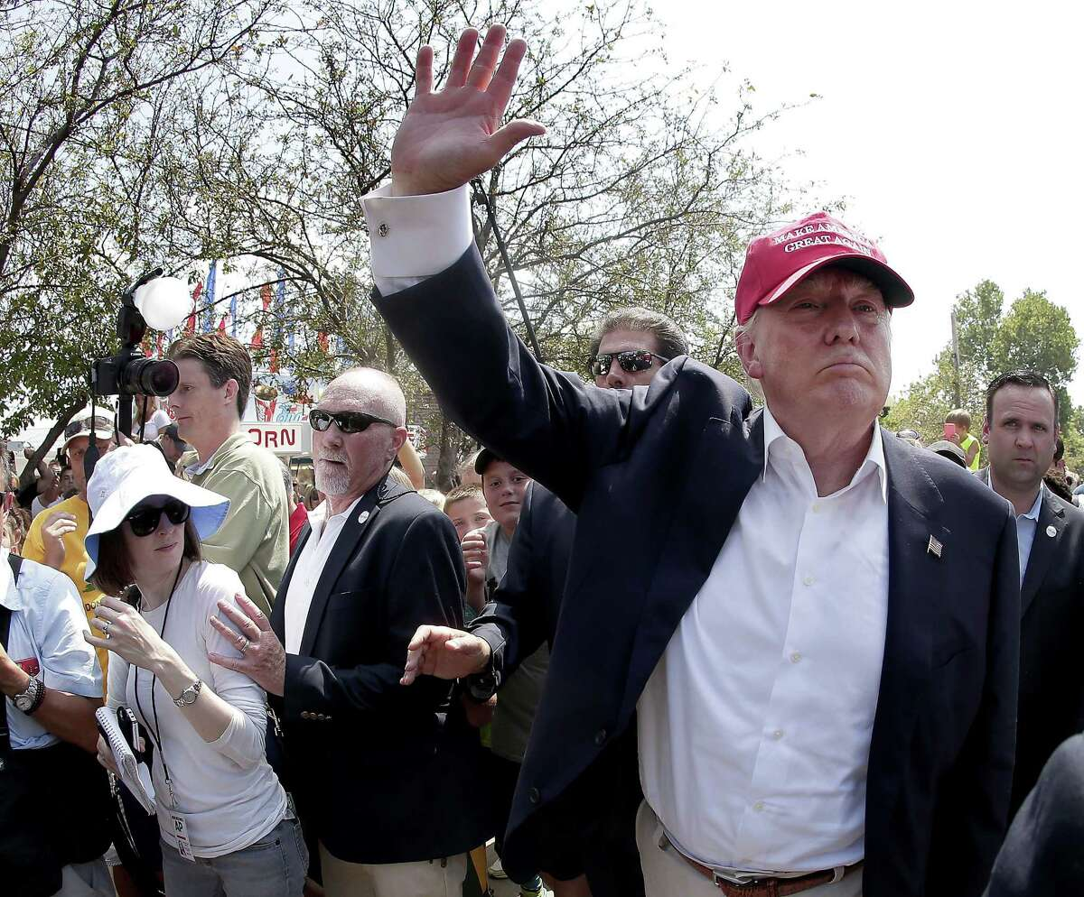 In this Aug. 15, 2015 photo, Republican presidential candidate Donald Trump waves to the crowd at the Iowa State Fair in Des Moines.