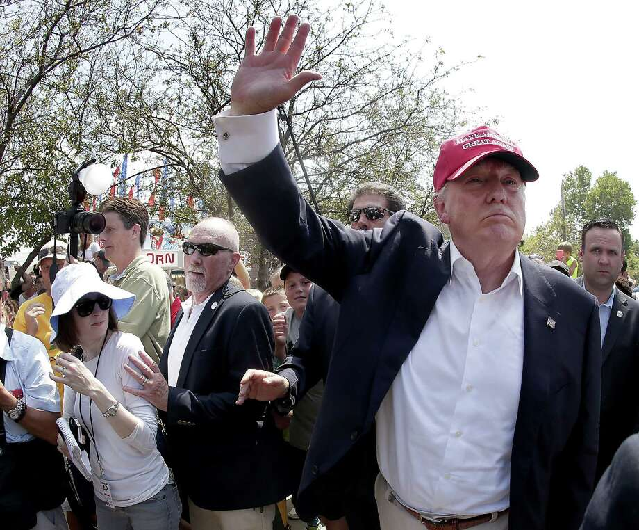 In this Aug. 15, 2015 photo, Republican presidential candidate Donald Trump waves to the crowd at the Iowa State Fair in Des Moines. Photo: AP Photo/Charlie Riedel, File   / AP