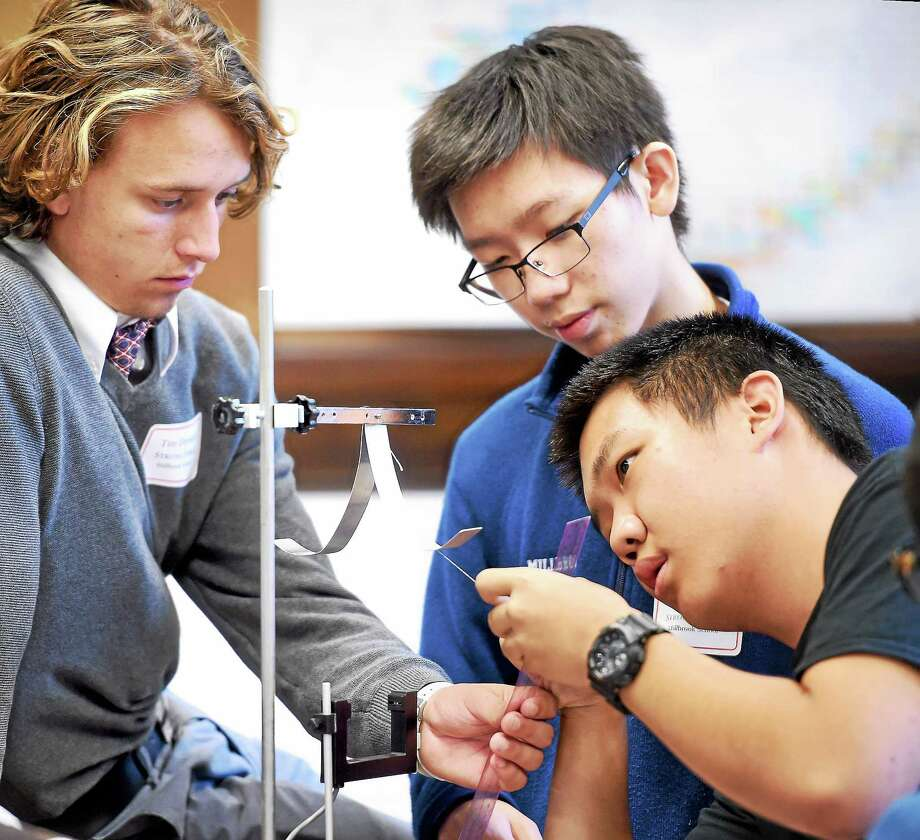 Left to right, Tim Drevitch, Jason Wei and Tom An of Millbrook School compete in the 18th annual Yale Physics Olympics at Yale University's Sloane Physics Lab in New Haven on 10/17/2015.  They are constructing a pendulum clock that can keep accurate time as the pendulum slows. Not shown is David Yu. Photo: Arnold Gold — New Haven Register
