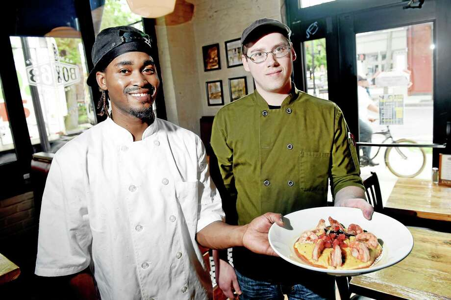 Sous Chef Jeffery Carr, left, and Executive Chef Nick Warner hold a dish of Shrimp N' Grits at Box 63 in New Haven. Photo: Arnold Gold — New Haven Register Photos
