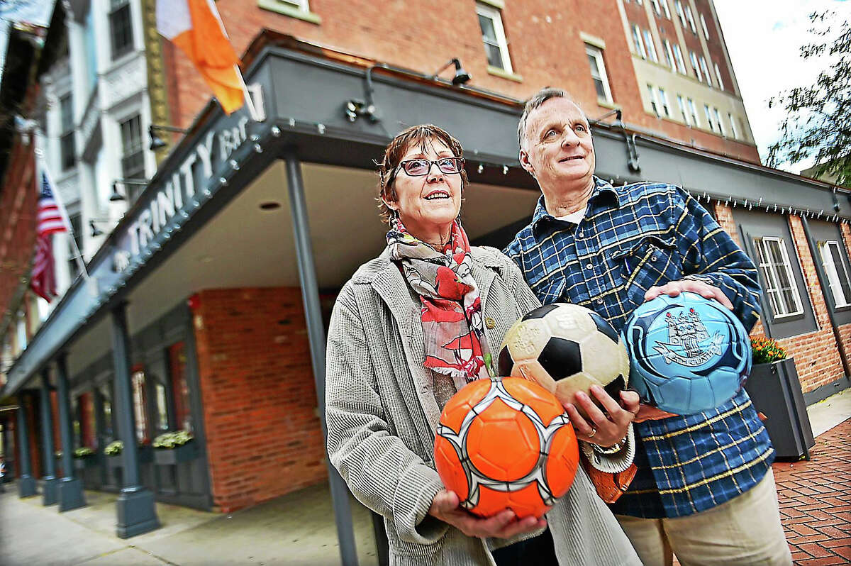 Deborah Flynn, an associate professor of Public Health at Southern Connecticut State University and Bill Madaras prepare for the 5th annual Kick for Nick Night, Friday, October 23, 2015 from 5 p.m. - 10 p.m. at the Trinity Bar & Restaurant at 157 Orange Street in New Haven. Admission can be made in the form of a new or used soccer ball, or a $15 tax-deductible donation. Bill Madaras is the father of PFC Nick Madaras, who was killed in September 2006 by a roadside bomb in Iraq. Shortly before Nick Madaras was killed, he was home on leave discussing his idea of getting soccer balls to children in Iraq. Madaras, a passionate soccer player at Wilton High School, saw Iraqi children playing soccer with tin cans or balls of rags. In memory of Nick, the Madaras family and friends established the Kick for Nick Foundation, which has distributed 43,500 soccer balls to children in developing countries through U.S. troops. Flynn distributed 90 soccer balls to Guatemala, the 22nd country affected by Kick for Nick.
