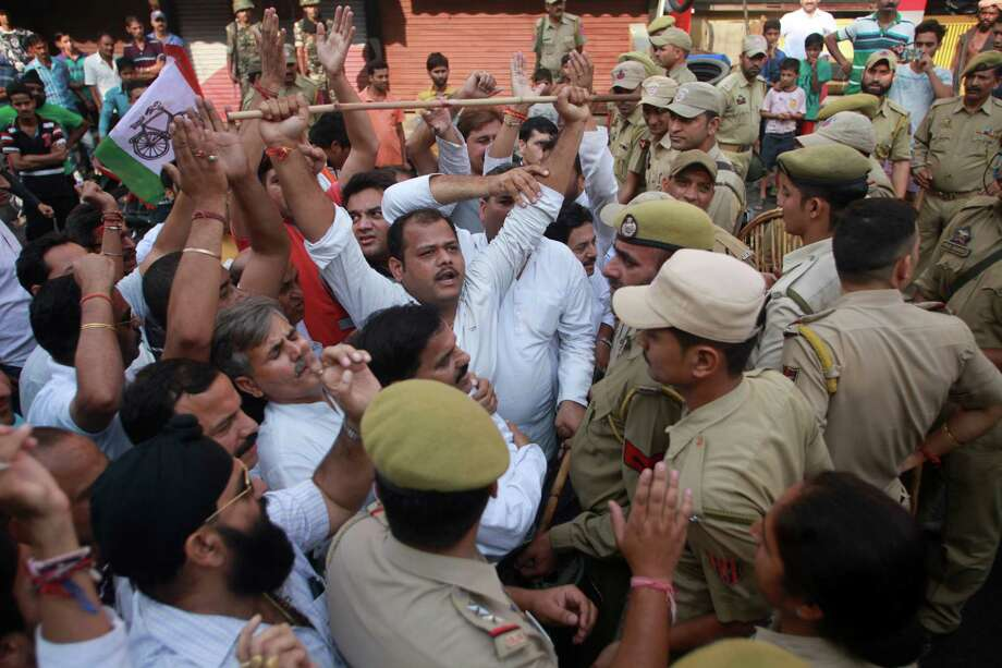 In this Saturday, Oct. 10, 2015 photo, activists of Jammu Kashmir National Panther Party shout slogans during a shutdown called against cow slaughter and against an independent state lawmaker for hosting a party where he served beef, in Jammu, India. Cows have long been sacred to Hindus, worshipped as a mother figure and associated since ancient times with the god Krishna. But increasingly, cows are also becoming a tool of political parties, an electioneering code word and a rallying cry for both Hindu nationalists and their opponents. Photo: (AP Photo/Channi Anand) / AP