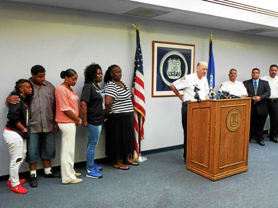 "The family of Torrence ""TJ"" Gamble gathers at a press conference Friday morning. Police Chief Dean Esserman is at the lectern. Photo: Ryan Flynn — New Haven Register"