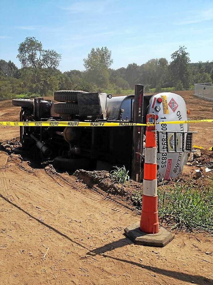 A fuel tanker flipped over near Guilford High School during construction Wednesday. Photo: Tim Rizzo- New Haven Register