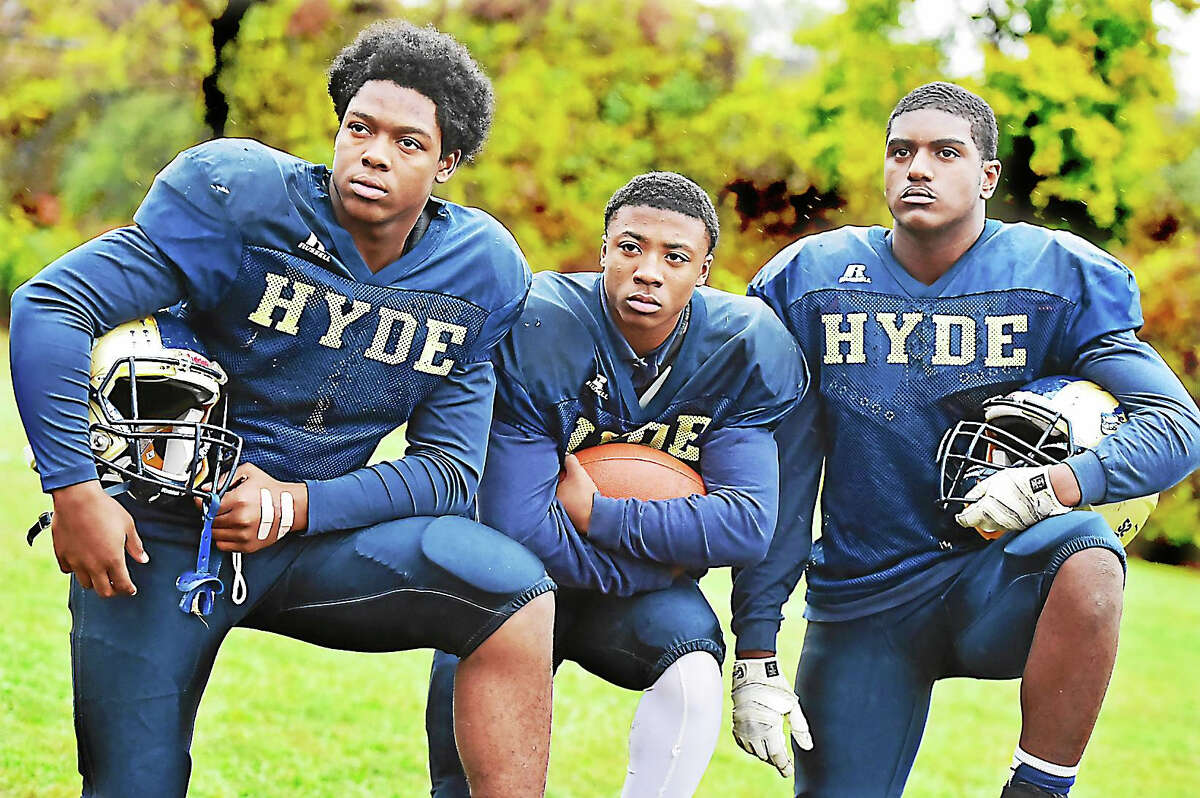 Hyde captains, from left: Ralik Garvins, a senior; Jhavion Haddock, a junior; and Latrell Alston, a senior, at practice this week at Blake Field in New Haven.