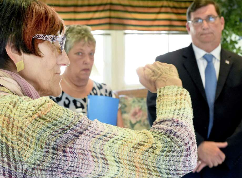 From left, U.S. Rep. Rosa L. DeLauro; Dale Phelan, president of the Surfside Senior Housing Tenants Council; and West Haven Mayor Ed O'Brien talk following a meeting Monday with officials resident representatives from several senior housing complexes. Photo: Peter Hvizdak — New Haven Register    / ©2015 Peter Hvizdak