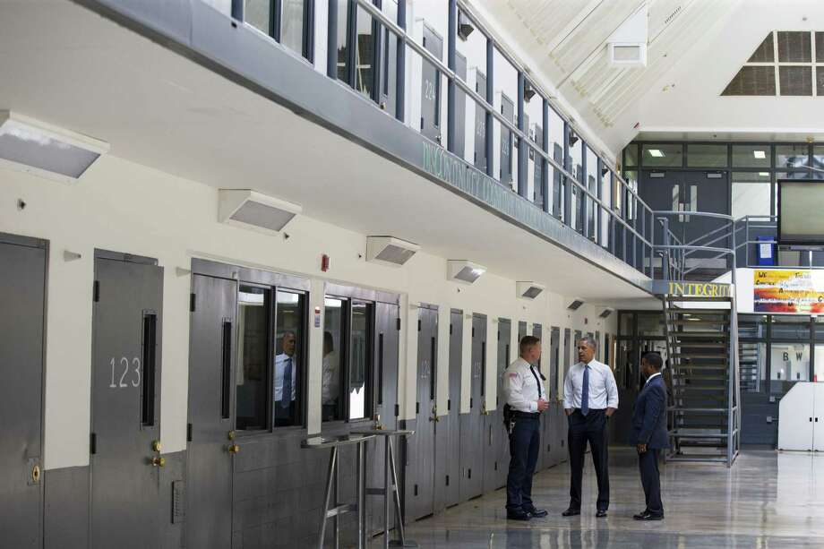 President Barack Obama is led on a tour by Bureau of Prisons Director Charles Samuels, right, and correctional officer Ronald Warlick during a visit to the El Reno Federal Correctional Institution, in El Reno, Okla., Thursday. Photo: AP Photo   / AP