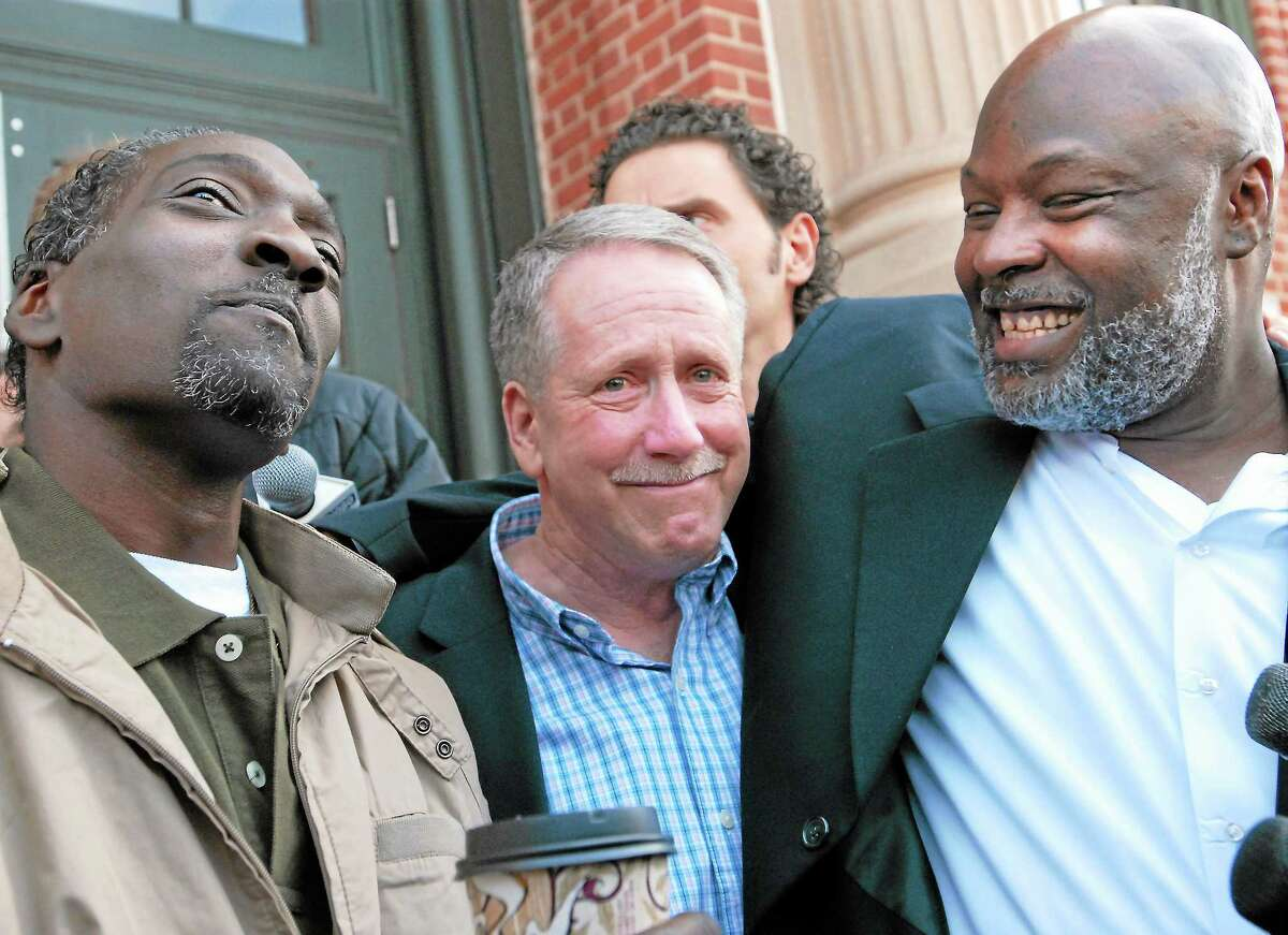 "Ronald Taylor, left, and George Gould, right, with private investigator G.J. ""Jerry"" O'Donnell of Cheshire, center, celebrate the release of Taylor and Gould in front of Rockville Superior Court on April 1, 2010."