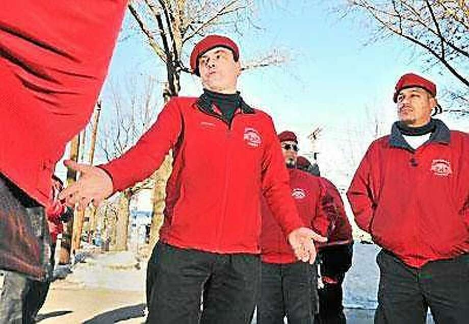 Curtis Sliwa speaks to other members of the Guardian Angels outside the police substation on Whalley Avenue in 2011. Photo: File Photo