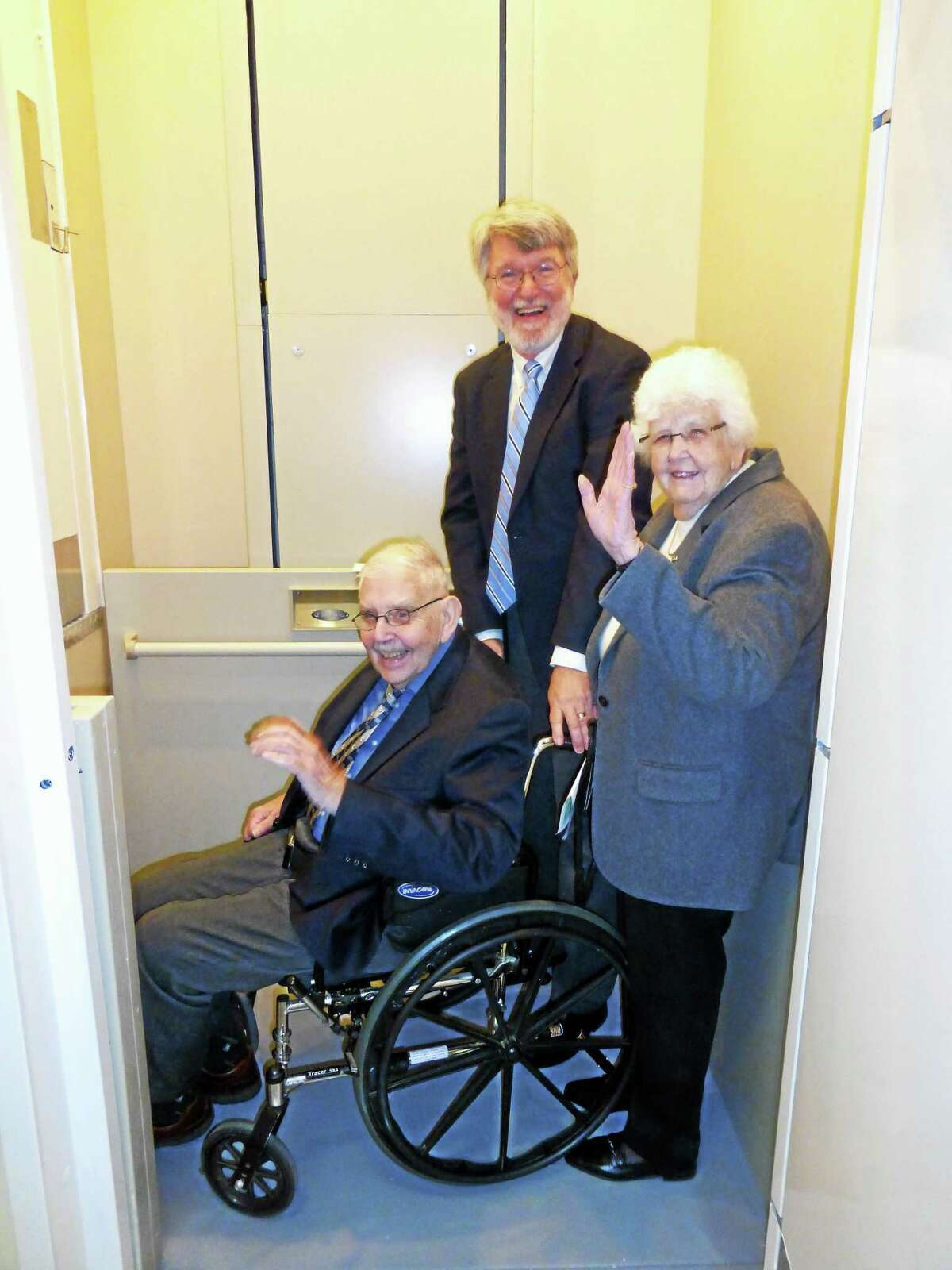 Karl Kregling, church moderator, with parishioners Dorothy and Robert Marshall, whose generous donation from their sister's memorial fund made elevator/project possible