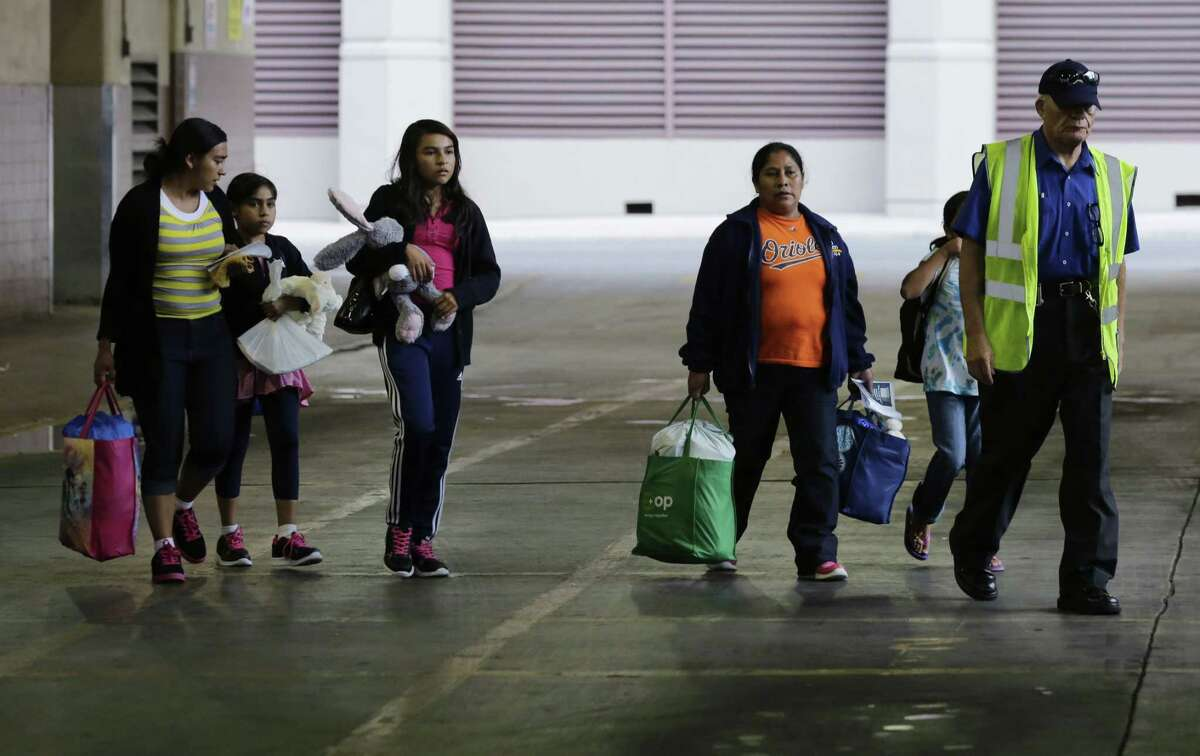 In this July 7 file photo, immigrants from El Salvador and Guatemala who entered the country illegally board a bus after they were released from a family detention center in San Antonio.