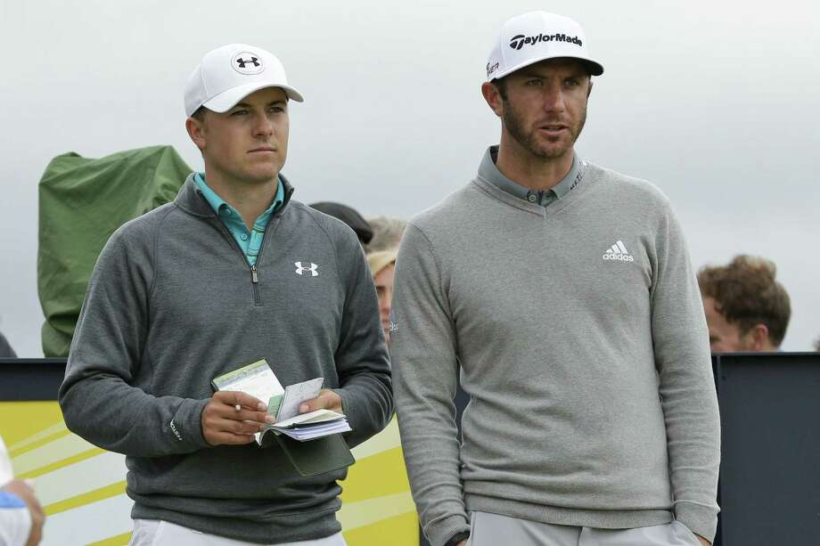 Jordan Spieth, left, and Dustin Johnson speak before hitting from the 15th tee during the first round of the British Open on Thursday at the Old Course, St. Andrews, Scotland. Photo: David J. Phillip — The Associated Press   / AP