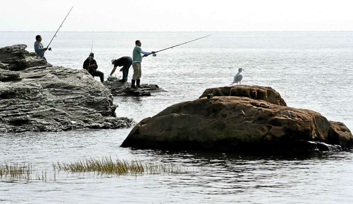 (Arnold Gold-New Haven Register) Fishermen cast into the waters of Long Island Sound at Merwin Point in the Woodmont section of Milford during high tide on 9/28/2015.