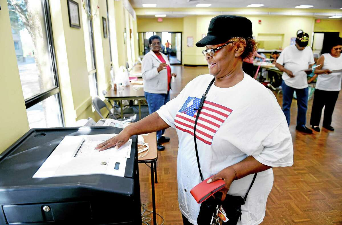 Mary Maye votes at the Bella Vista senior housing complex in New Haven Wednesday.