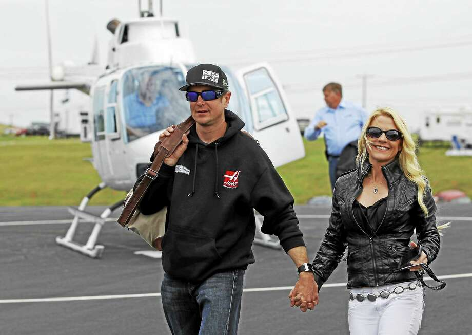 In this May 17, 2014 file photo, Kurt Busch, left, walks with his girlfriend, Patricia Driscoll, after arriving for the NASCAR Sprint All-Star race at Charlotte Motor Speedway in Concord, N.C. Photo: Terry Renna — The Associated Press File Photo   / FR60642 AP