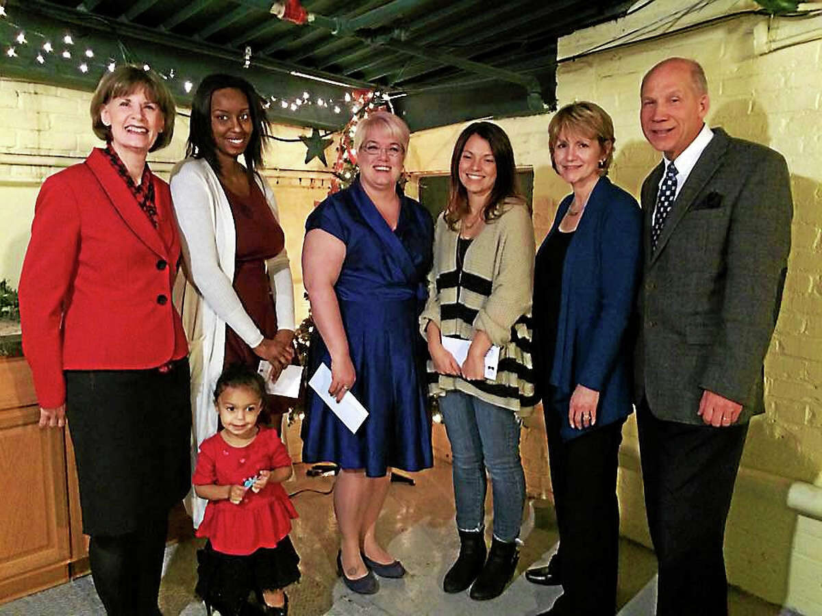 From left, Sharon Massafra, chairwoman of the WIN Grant Selection Committee; Samonna Jones, owner of Party Unique Boutique, with her and daughter; Tracy Tenpenny, owner of Tea with Tracy; Alyssa DeMatteo, owner of Wildflour Confections; Mary Jo Romano, WIN chairwoman; and Bill Purcell, president, Greater Valley Chamber of Commerce.