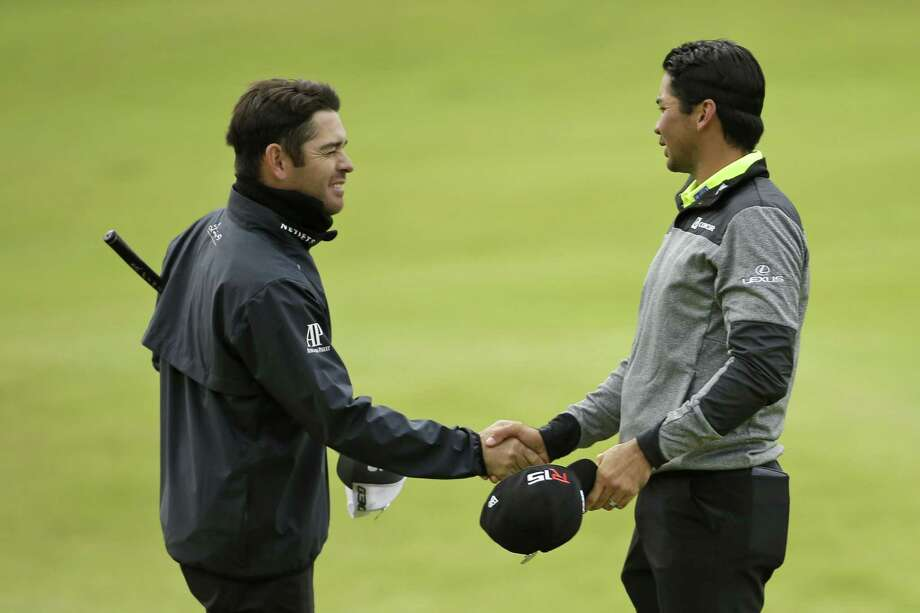 Jason Day, right, shakes hands with Louis Oosthuizen on the 18th green following their first round at the British Open on Thursday at the Old Course, St. Andrews, Scotland. Photo: David J. Phillip — The Associated Press   / AP