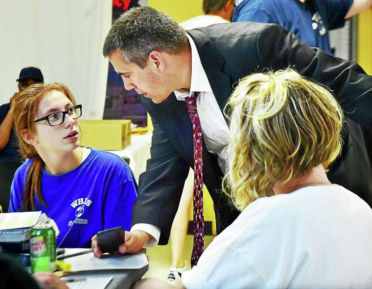 West Haven City Council Chairman Nick Pascale talks with his 15-year-old daughter, Devin, and his wife Angela, Wednesday at his campaign headquarters on Jones Hill Road.