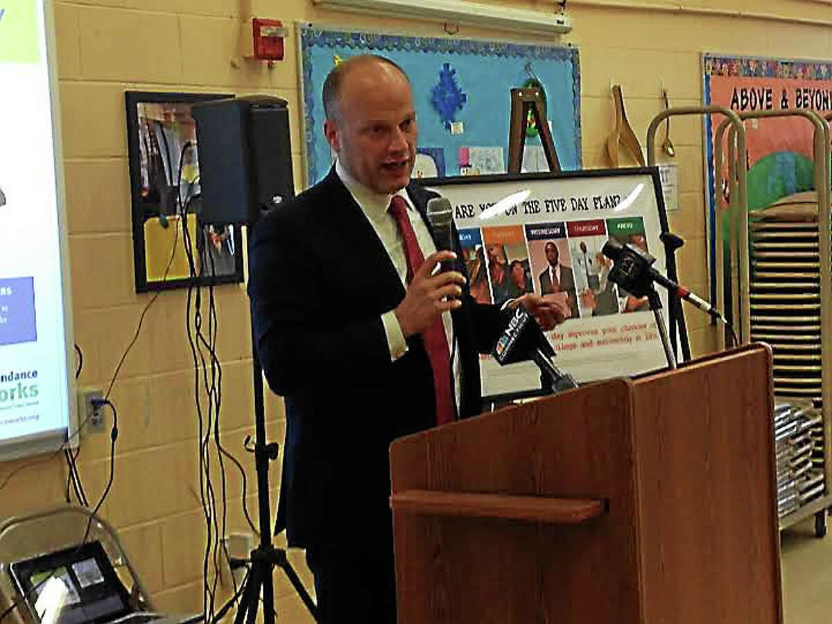 Superintendent of Schools Garth Harries speaks about a decrease in chronically absent students at Quinnipiac Real World Magnet Math STEM School in New Haven.