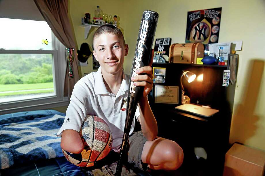 Hayden Piterski, 13, is photographed at his home in Hamden. Photo: Arnold Gold — Register