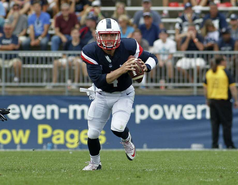 UConn quarterback Bryant Shirreffs (4) runs out of the pocket during a game against Army. Photo: Stew Milne  — The Associated Press   / FR56276 AP