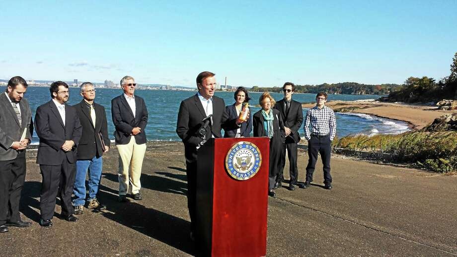 U.S. Sen. Chris Murphy, D-Conn., calls on manufacturers to ban sale of plastic microbeads in personal care products. Photo: Anna Bisaro — New Haven Register