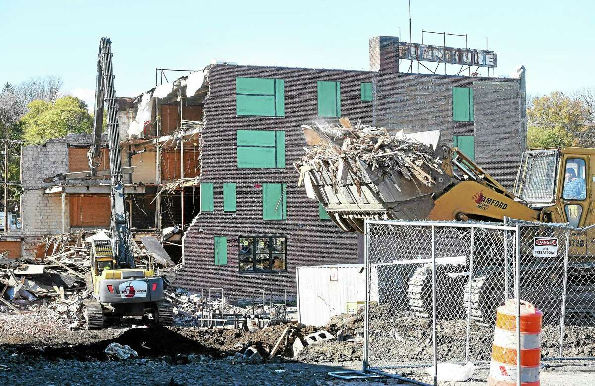 The Carroll Cut-Rate Furniture building is demolished Friday in West Haven.