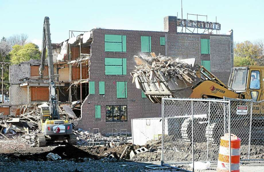 The Carroll Cut-Rate Furniture building is demolished Friday in West Haven. Photo: Arnold Gold — New Haven Register
