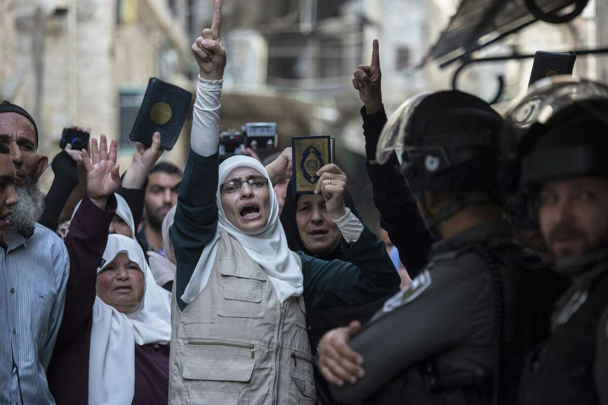 Palestinians chant slogans during a protest in Jerusalem's old city on Sep. 13, 2015. Israeli police briefly clashed with Palestinian protesters at Jerusalem's most sensitive holy site early Sunday, raising tensions in the holy city ahead of the Jewish New Year.