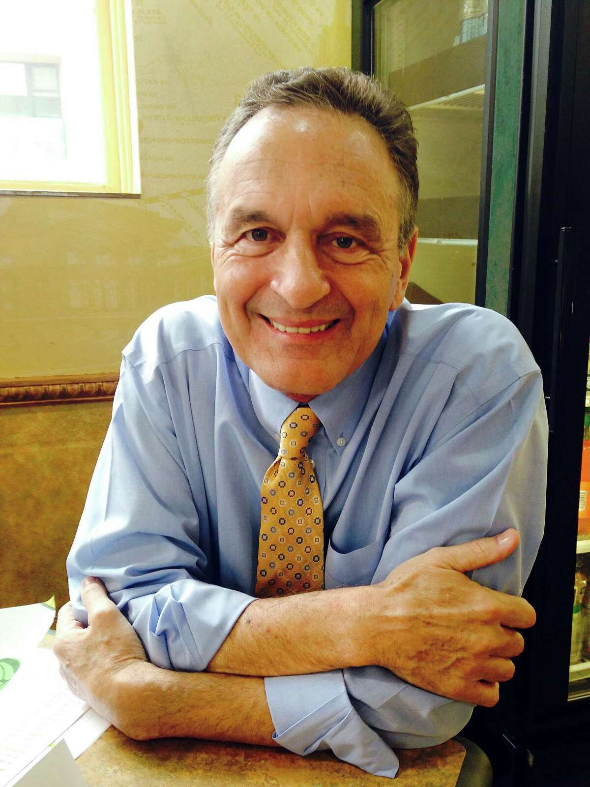 In this May 16, 2014 photo, Subway co-founder Fred DeLuca poses for a photo at a Subway restaurant in New York.