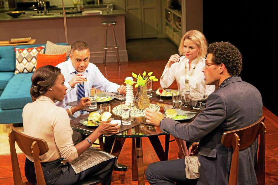 "Shirine Babb (Jory), left, Rajesh Bose (Amir), Nicole Lowrance (Emily) and Benim Foster (Isaac) in Ayad Akhtar's ""Disgraced,"" which continues at LWT through Nov. 8. Photo: © T. Charles Erickson Photography"