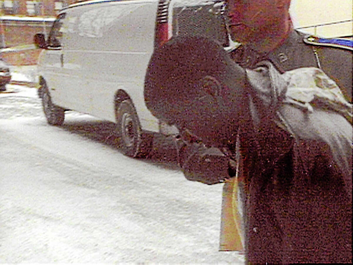 Russell Peeler is led into Bridgeport Superior Court, Thursday, Jan. 14, 1999, for his arraignment on a weapons charge where he was ordered held in lieu of a $750,000 cash bond.