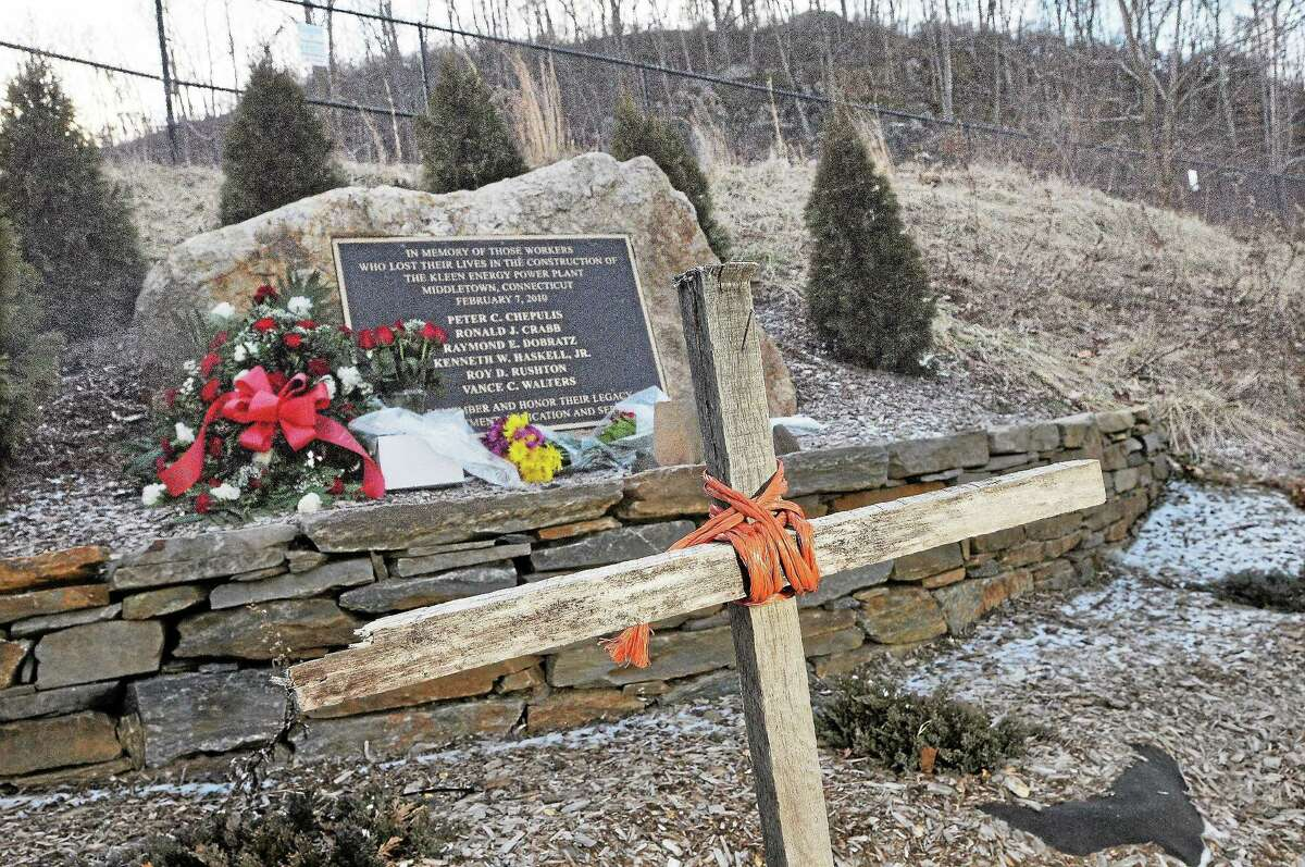 A memorial made using a makeshift cross and a bronze plaque set in stone has been set up about a mile east of the Kleen Energy Power Plant on River Road in Middletown, shown here on the three-year anniversary of the explosion that killed six workers, Peter C. Chepulis, Ronald J. Crabb, Raymond E. Dobratz, Kenneth W. Haskell Jr., Roy D. Rushton and Vance C. Walters.
