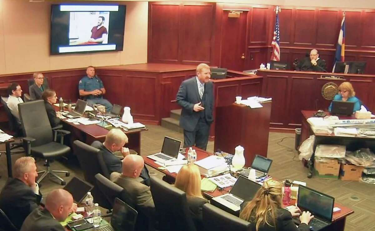 In this image taken from video, accused Colorado theater shooter James Holmes, on the upper far left, listens to defense attorney Daniel King give closing arguments during his trial, in Centennial, Colo., Tuesday.