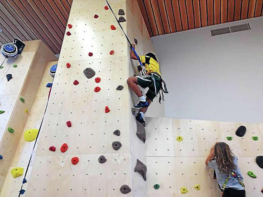 Fifth-grader Savan climbs Cold Spring School's month-old rock wall. (Brian Zahn - New Haven Register) Photo: Journal Register Co.